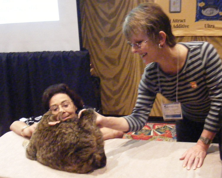 Penny Bydlinski (left) and Leslie Morgan (right) admire an example of an American Bobtail.